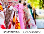 closeup of some clothes hanging ... | Shutterstock . vector #1397310590