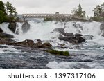A River And Bridge By One Of...