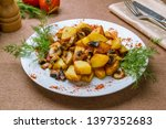 fried potatoes with mushrooms... | Shutterstock . vector #1397352683