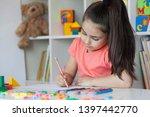 happy cute child girl sitting...   Shutterstock . vector #1397442770