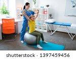 grey pilates ball. attentive... | Shutterstock . vector #1397459456