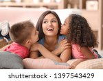 young woman with little kids... | Shutterstock . vector #1397543429