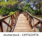 bridge built with logs in the... | Shutterstock . vector #1397623976