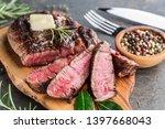 medium rare ribeye steak with... | Shutterstock . vector #1397668043