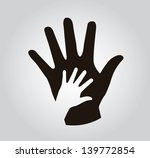 hands silhouette over gray...