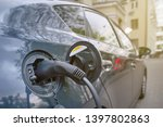 charging electric car in public ... | Shutterstock . vector #1397802863