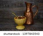Tea Pot On A Table With A...