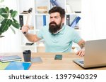 Businessman With Beard And...
