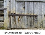 Rusty Hinge On An Old Wooden...