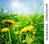 yellow fresh dandelions against ... | Shutterstock . vector #1398102149