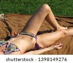 slim girl in bikini sunbathing...   Shutterstock . vector #1398149276