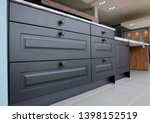 Stock photo black wooden kitchen cabinet with drawers and quartz stone worktop 1398152519