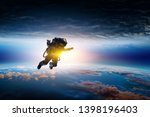 spaceman and planet  human in... | Shutterstock . vector #1398196403