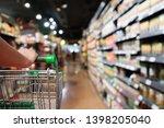 woman hand hold shopping cart... | Shutterstock . vector #1398205040