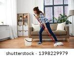 people  housework and... | Shutterstock . vector #1398229979