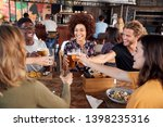 group of young friends meeting... | Shutterstock . vector #1398235316