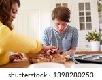 young downs syndrome couple... | Shutterstock . vector #1398280253