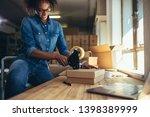 smiling female entrepreneur... | Shutterstock . vector #1398389999