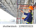 Foreman Inspecting Scaffolding...