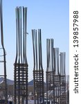 Rebar frames on a building construction site - stock photo