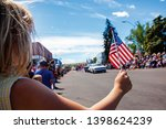 Girl holding usa flag at 4th of ...