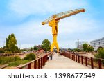 Small photo of NANTES, FRANCE - SEPTEMBER 16, 2018: Grue Titan Jaune or Yellow Titan Crane is a abandoned crane on the tip of Nantes island in France