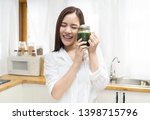 smiling happy young asian woman ... | Shutterstock . vector #1398715796