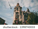 housw with a spire in the... | Shutterstock . vector #1398743033