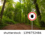 Tick insect warning sign in...