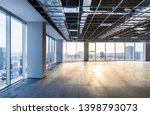 Small photo of Vacant office space offering views of the city. Open ceiling showing ventilation system. Shot just after construction was completed on a late winter afternoon in downtown Montreal, Quebec, Canada.