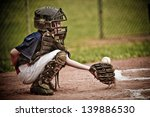 Baseball Catcher With Ball In...