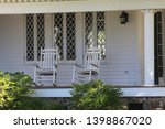 old southern porch rocking chair | Shutterstock . vector #1398867020