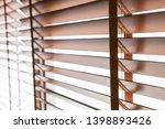 wooden shutters blind on the... | Shutterstock . vector #1398893426