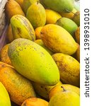 fresh mango in indian market  | Shutterstock . vector #1398931010
