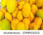 fresh mango in indian market  | Shutterstock . vector #1398931013