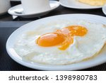 side view of fried eggs serve... | Shutterstock . vector #1398980783