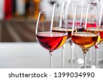 glasses with different wines on ... | Shutterstock . vector #1399034990