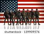 Eight isolated U.S. Marines. on the smooth floor. Soldiers against the background of the American/USA flag.
