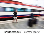 urgent woman at the train station in motion blur - stock photo
