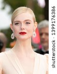 """Small photo of Jury member Elle Fanning attends the opening ceremony and screening of """"The Dead Don't Die"""" during the 72nd annual Cannes Film Festival on May 14, 2019 in Cannes, France."""