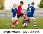 young football players kicking... | Shutterstock . vector #1399185146