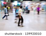 security man at the airport with intentional motion blur - stock photo