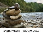 closeup stone cairn against the ... | Shutterstock . vector #1399259069