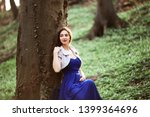 beautiful girl in a blue dress... | Shutterstock . vector #1399364696