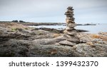 cairn on a hiking trail on the... | Shutterstock . vector #1399432370
