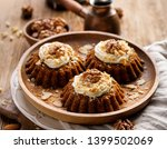 carrot nut muffins with... | Shutterstock . vector #1399502069