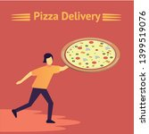 a man holding a pizza in his...