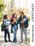 three young students in the... | Shutterstock . vector #1399576619