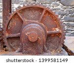 a large old rusty cogwheel on... | Shutterstock . vector #1399581149