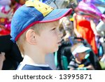 Kid looking very seriously - stock photo
